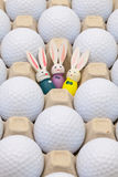 Golf balls in the box for eggs and Easter decoration Royalty Free Stock Image
