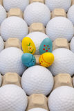 Golf balls in the box for eggs and Easter decoration Stock Image