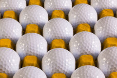 Golf balls in box for eggs Stock Images