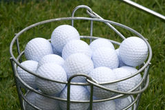 Golf Balls in Bucket on the Green Royalty Free Stock Image