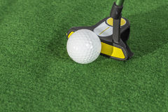 Golf Balls Close. A close shot of a group of golf balls with a lone yellow ball Stock Image