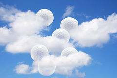 Golf Balls and Clouds. On Blue Sky Royalty Free Stock Photography