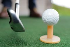 Golf balls and golf club on green grass stock photography