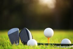 Golf balls and golf clubs as well as equipment used to play golf on green grass