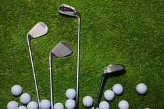 Golf balls and clubs on grass Royalty Free Stock Photo