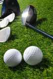 Golf balls and clubs on grass Royalty Free Stock Images