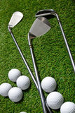 Golf balls and clubs on grass Royalty Free Stock Photos