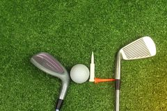 Golf balls and golf clubs on green grass. Golf equipment in the top view.Sports that people around the world play during the holidays for health stock photography