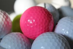 Golf balls colorful pink white yellow Royalty Free Stock Photos