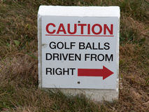 Golf balls driven from right stock images