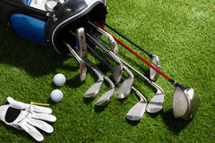 Golf balls,glove,tee,and clubs in the bag Stock Photography