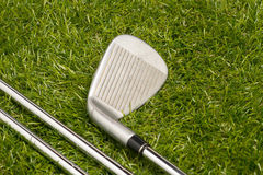 Golf balls and golf clubs Stock Image