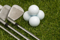 Golf balls and golf clubs Royalty Free Stock Image