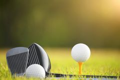 Golf balls and golf clubs as well as equipment used to play golf on green grass stock photography