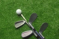 Golf balls and golf clubs on green grass. Golf equipment in the top view.Sports that people around the world play during the holidays for health stock photo