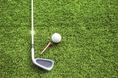Golf balls and golf clubs on green grass. Golf equipment in the top view.Sports that people around the world play during the holidays for health royalty free stock image