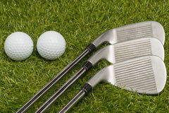 Golf balls and golf clubs Royalty Free Stock Photography