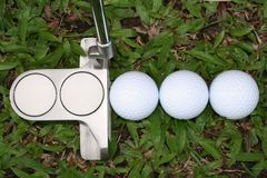 Golf balls and golf putter Royalty Free Stock Photos