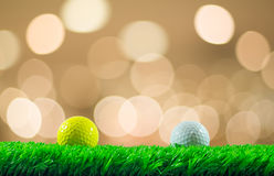 Golf balls on grass Stock Images