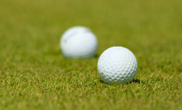 Golf balls on the green field of the stadium. Golf balls on the green field Stock Photo