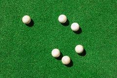 Golf balls on green grass Royalty Free Stock Photos