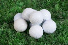 Golf Balls On Green Grass Stock Image