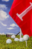 Golf balls, green grass, clouds background Royalty Free Stock Photo