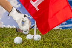 Golf balls, green grass, clouds background Royalty Free Stock Image