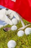 Golf balls, green grass, clouds background Stock Images