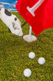 Golf balls, green grass, clouds background Stock Images