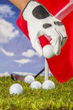 Golf balls, green grass, clouds background Stock Photo