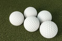 Golf balls on green grass Royalty Free Stock Photography