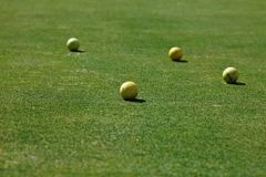 Golf balls on the green grass stock images