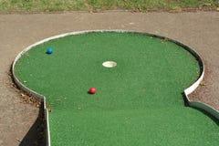 Golf balls on green Stock Photos