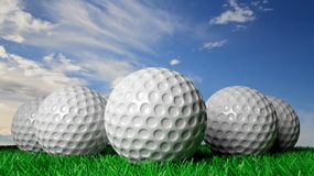 Golf balls on green turf Royalty Free Stock Photos