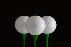 Golf balls and green wooden tees Stock Photo