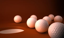 Golf balls and hole. Several golf balls gathered around the edge of a golf hole or cup.  Brown background Royalty Free Stock Photography