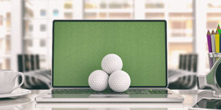 Golf balls on a laptop - office background. 3d illustration Stock Photo