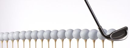 Golf balls lined up and ready to hit Royalty Free Stock Photo