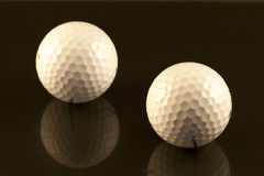 Golf balls Stock Images