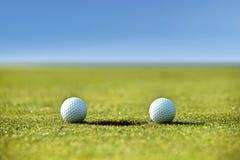 Golf balls near hole Stock Images
