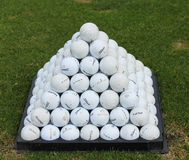 Golf balls pyramid on driving range Royalty Free Stock Images