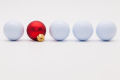 Golf balls and red  Christmas decoration Stock Photo
