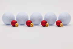 Golf balls and red  Christmas decoration Royalty Free Stock Photos