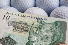 Golf balls and South Africa banknotes Royalty Free Stock Photo