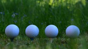 Golf balls that symbolize when one falls so everyone follows
