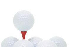 Golf balls and tee. Arranged on white background with copy space Stock Images