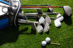 Golf balls,tee and clubs in the bag Stock Image