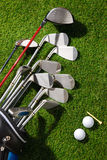 Golf balls,tee and clubs in the bag Stock Photos
