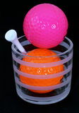 Golf balls with tee in a drinking glass Royalty Free Stock Photos